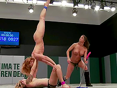 A bitch gets beaten and fucked by two lesbians on tatami