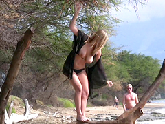 Danielle shows her body and fingers her shaved pussy at a beach