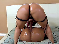 Bubble butt ebony sluts having fun with a big long strap-on